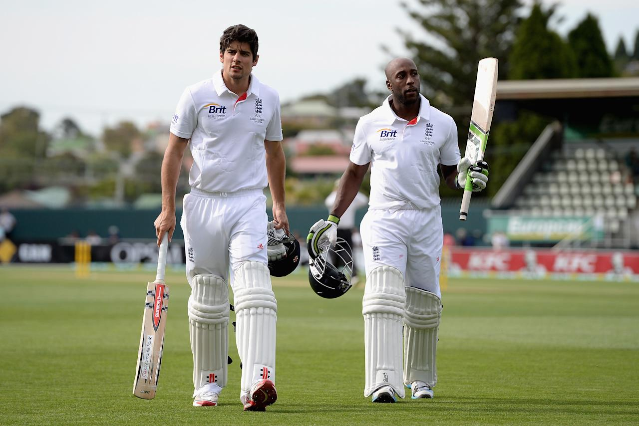 HOBART, AUSTRALIA - NOVEMBER 06:  England captain Alastair Cook and Michael Carberry salute the crowd as they leave the field at the end of day one of the tour match between Australia A and England at Blundstone Arena on November 6, 2013 in Hobart, Australia.  (Photo by Gareth Copley/Getty Images)