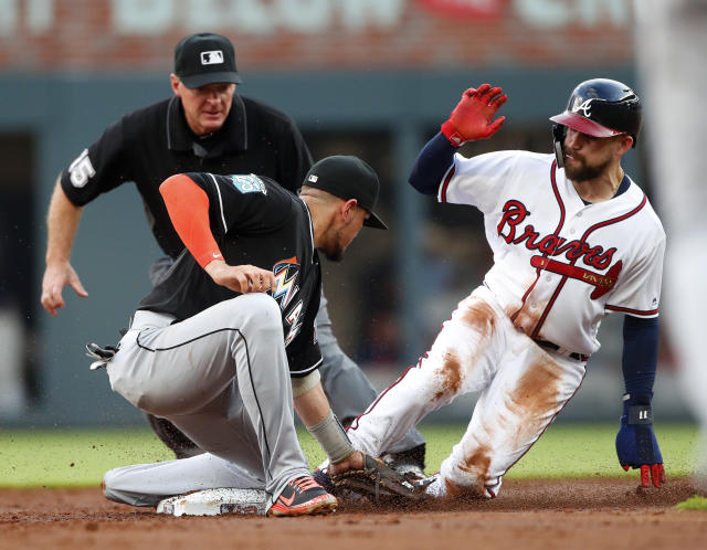 Atlanta Braves' Ender Inciarte, right, is tagged out by Miami Marlins shortstop Miguel Rojas as he tried to steal second base during the second inning of a baseball game Saturday, May 19, 2018, in Atlanta. (AP Photo/John Bazemore)