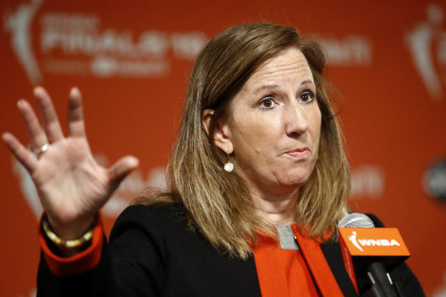 FILE - In this Sept. 29, 2019, file photo, WNBA Commissioner Cathy Engelbert speaks at a news conference before Game 1 of basketball's WNBA Finals in Washington. Engelbert said in a phone interview with The Associated Press on Friday, May 15, 2020, that the league is focusing on about a half dozen scenarios to play this summer during the coronavirus pandemic. Engelbert did not go into detail about each scenario, but said that they are looking at playing in either one or a couple of sites at most instead of at every home arena. (AP Photo/Patrick Semansky, File)