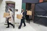 Federal agents remove boxes of evidence from the building that houses the Sergeants Benevolent Association offices, Tuesday, Oct. 5, 2021, in New York. Federal agents raided the offices of the New York City police union whose leader has clashed with city officials over his incendiary tweets and hard-line tactics. They also raided the Long Island home of Sergeants Benevolent Association president Ed Mullins. (AP Photo/Mary Altaffer)
