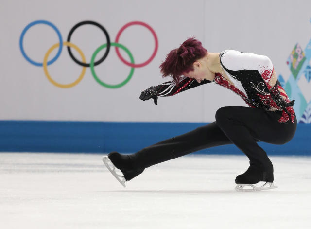 Misha Ge of Uzbekistan competes in the men's free skate figure skating final at the Iceberg Skating Palace during the 2014 Winter Olympics, Friday, Feb. 14, 2014, in Sochi, Russia. (AP Photo/Ivan Sekretarev)