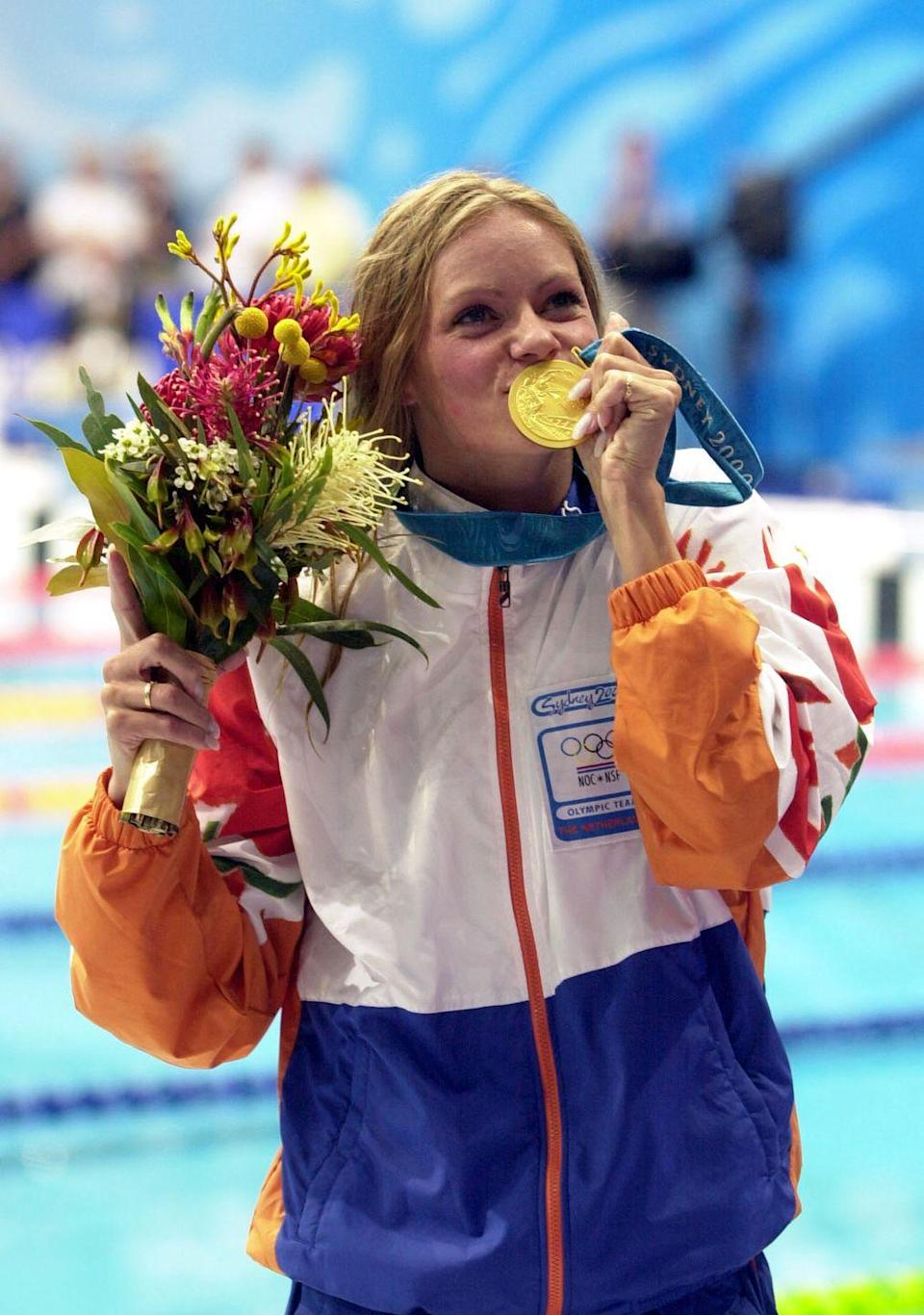 """<p>Inge de Bruijn made quite the splash in Sydney, Australia. The swimmer from the Netherlands took home gold medals in the 50m and 100m freestyles and the 100m butterfly, while <a href=""""https://ishof.org/inge-de-bruijn.html"""" rel=""""nofollow noopener"""" target=""""_blank"""" data-ylk=""""slk:setting world records"""" class=""""link rapid-noclick-resp"""">setting world records</a> in each of the three categories.</p>"""