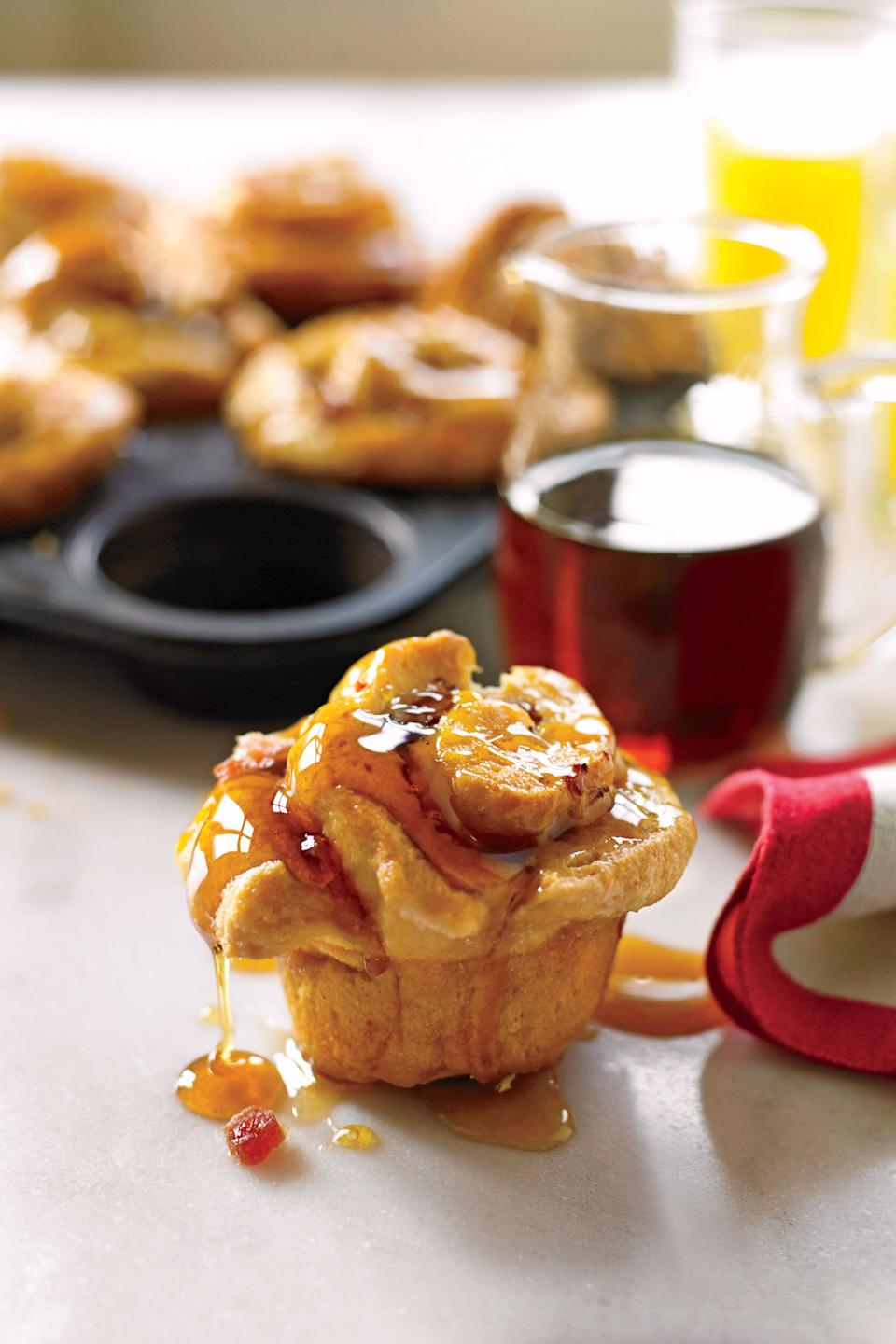 """<p><strong>Recipe:</strong> <a href=""""http://www.myrecipes.com/recipe/ham-swiss-sticky-buns-50400000131955/"""" rel=""""nofollow noopener"""" target=""""_blank"""" data-ylk=""""slk:Ham-and-Swiss Sticky Buns"""" class=""""link rapid-noclick-resp""""><strong>Ham-and-Swiss Sticky Buns</strong></a></p> <p>Stuff the dough deep into the muffin cups so that the tops rise into a cheesy dome while baking.</p>"""