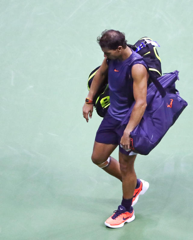 Rafael Nadal, of Spain, leaves the court after retiring from a match against Juan Martin del Potro, of Argentina, during the semifinals of the U.S. Open tennis tournament, Friday, Sept. 7, 2018, in New York. (AP Photo/Frank Franklin II)