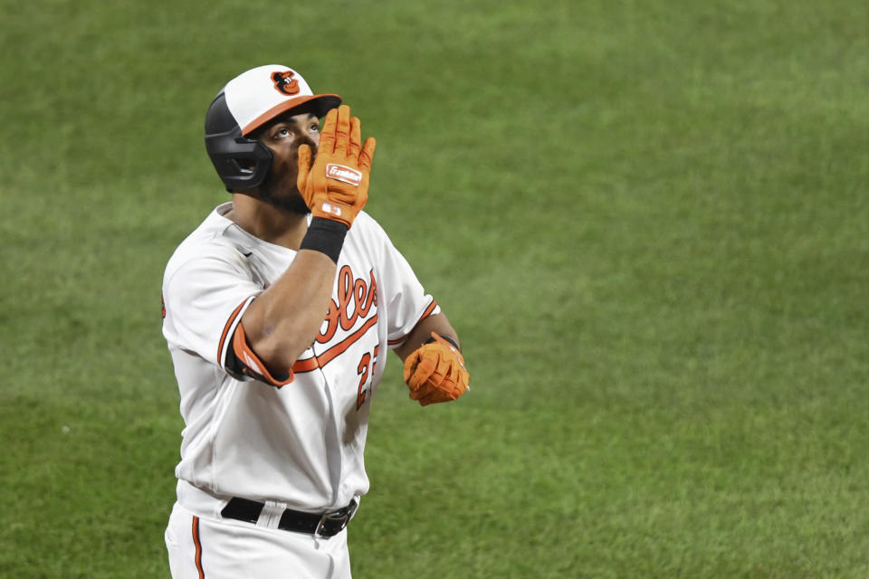 Baltimore Orioles' Anthony Santander gestures towards the sky after hitting a two-run home run which scored Baltimore Orioles' Trey Mancini against Los Angeles Angels relief pitcher Andrew Wantz during the sixth inning of a baseball game Tuesday, Aug. 24, 2021, in Baltimore. (AP Photo/Terrance Williams)