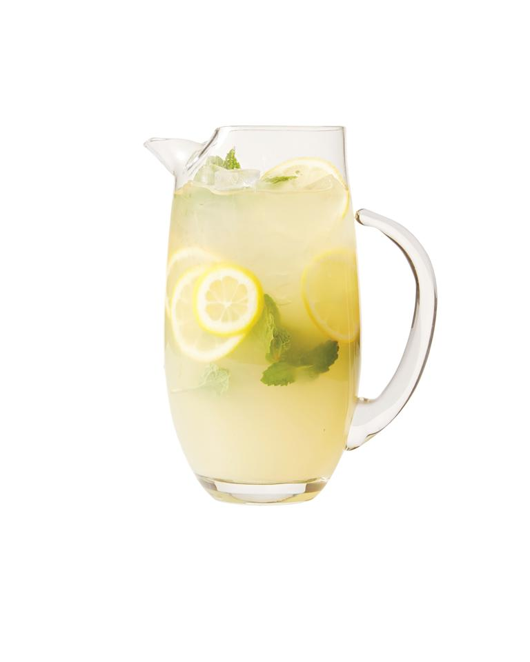 <p>Of course we're starting with Martha's own recipe. It uses lemons in three ways: the juice, slices, and a syrup made with lemons sweetens the drink.</p>