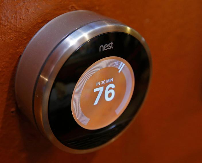 A Nest thermostat is seen on a wall in a home on January 16, 2014 in Provo, Utah.