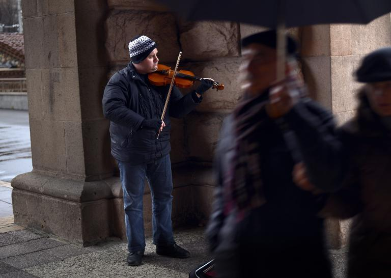 Martin Koleshev, who lives with his parents in a one bedroom flat in the town of Buhovo outside Sofia, plays the violin in the street in central Sofia on April 1, 2015