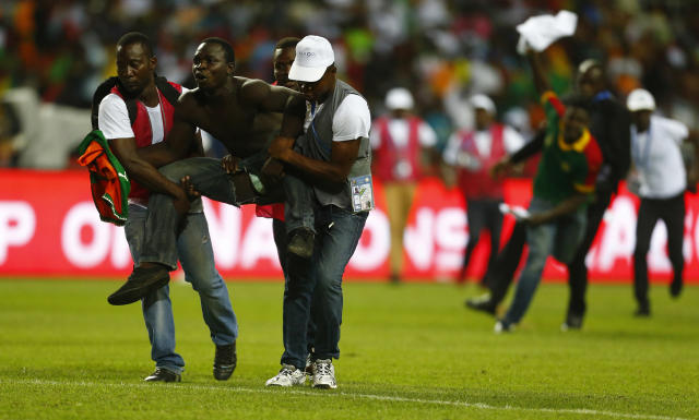 Football Soccer - African Cup of Nations - Final - Egypt v Cameroon - Stade d'Angondjé - Libreville, Gabon - 5/2/17 Cameroon fan is tackled by security after invading the pitch Reuters / Amr Abdallah Dalsh Livepic