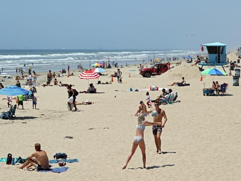 People gather at the beach amid the coronavirus pandemic on May 15, 2020 in Huntington Beach, California.