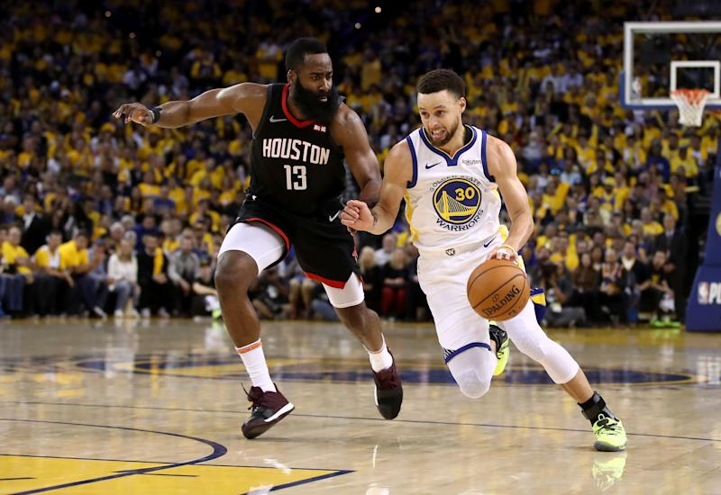 OAKLAND, CALIFORNIA - MAY 08: James Harden #13 of the Houston Rockets guards Stephen Curry #30 of the Golden State Warriors during Game Five of the Western Conference Semifinals of the 2019 NBA Playoffs at ORACLE Arena on May 08, 2019 in Oakland, California. NOTE TO USER: User expressly acknowledges and agrees that, by downloading and or using this photograph, User is consenting to the terms and conditions of the Getty Images License Agreement. (Photo by Ezra Shaw/Getty Images)