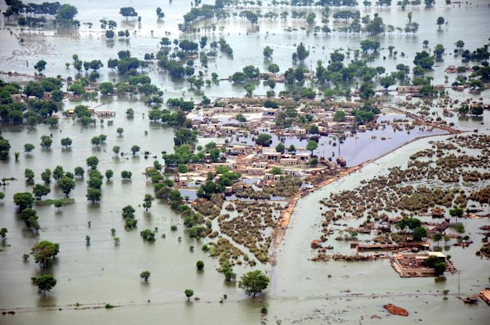 FILE - This Aug. 14, 2010 file photo shows an aerial view of the flooded Rohjan area in southern Pakistan. U.N. climate experts say global warming accelerated since the 1970s, breaking more countries' temperature records than ever before. The World Meteorological Organization's analysis Wednesday, July 3, 2013 calls the first decade of the new millennium an unprecedented era of climate extremes ranging from heat waves in Europe and Russia, to droughts in the Amazon Basin, Australia and East Africa, to huge storms like Tropical Cyclone Nargis and Hurricane Katrina.(AP Photo/Khalid Tanveer, File)