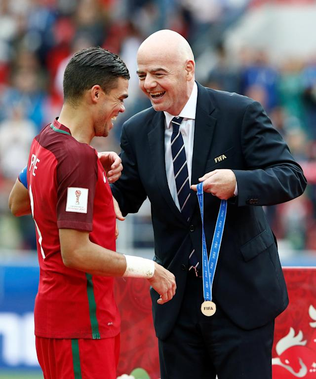 Soccer Football - Portugal v Mexico - FIFA Confederations Cup Russia 2017 - Third Placed Play Off - Spartak Stadium, Moscow, Russia - July 2, 2017 Portugal's Pepe is presented with his medal by FIFA President Gianni Infantino after the game REUTERS/Sergei Karpukhin