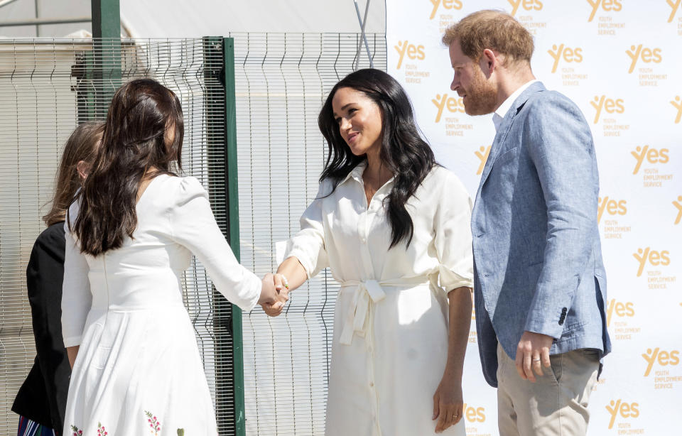 Britain's Prince Harry and Meghan, Duchess of Sussex visit a Youth Employment Services Hub in Makhulong, Tembisa, a township near Johannesburg, South Africa, Wednesday Oct. 2, 2019. The royal couple are on the last of their 10 day Africa tour. (AP Photo/Christiaan Kotze)