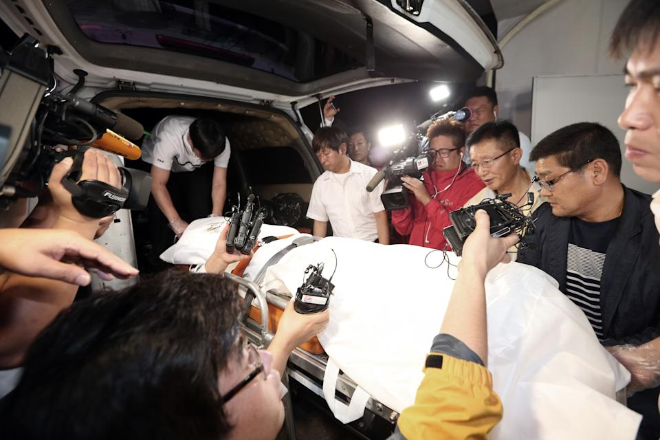 The body of a man believed to be the fugitive owner of the sunken ferry Sewol is carried into an ambulance at a funeral hall in Suncheon, South Korea, Tuesday, July 22, 2014. South Korean police said Tuesday that they have found the body of a fugitive billionaire businessman sought over April's ferry disaster that left more than 300 people dead or missing.(AP Photo/Yonhap, Park Chul-hong) KOREA OUT