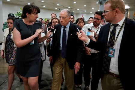Sen. Chuck Grassley speaks with reporters on the from the Senate floor on Capitol Hill in Washington