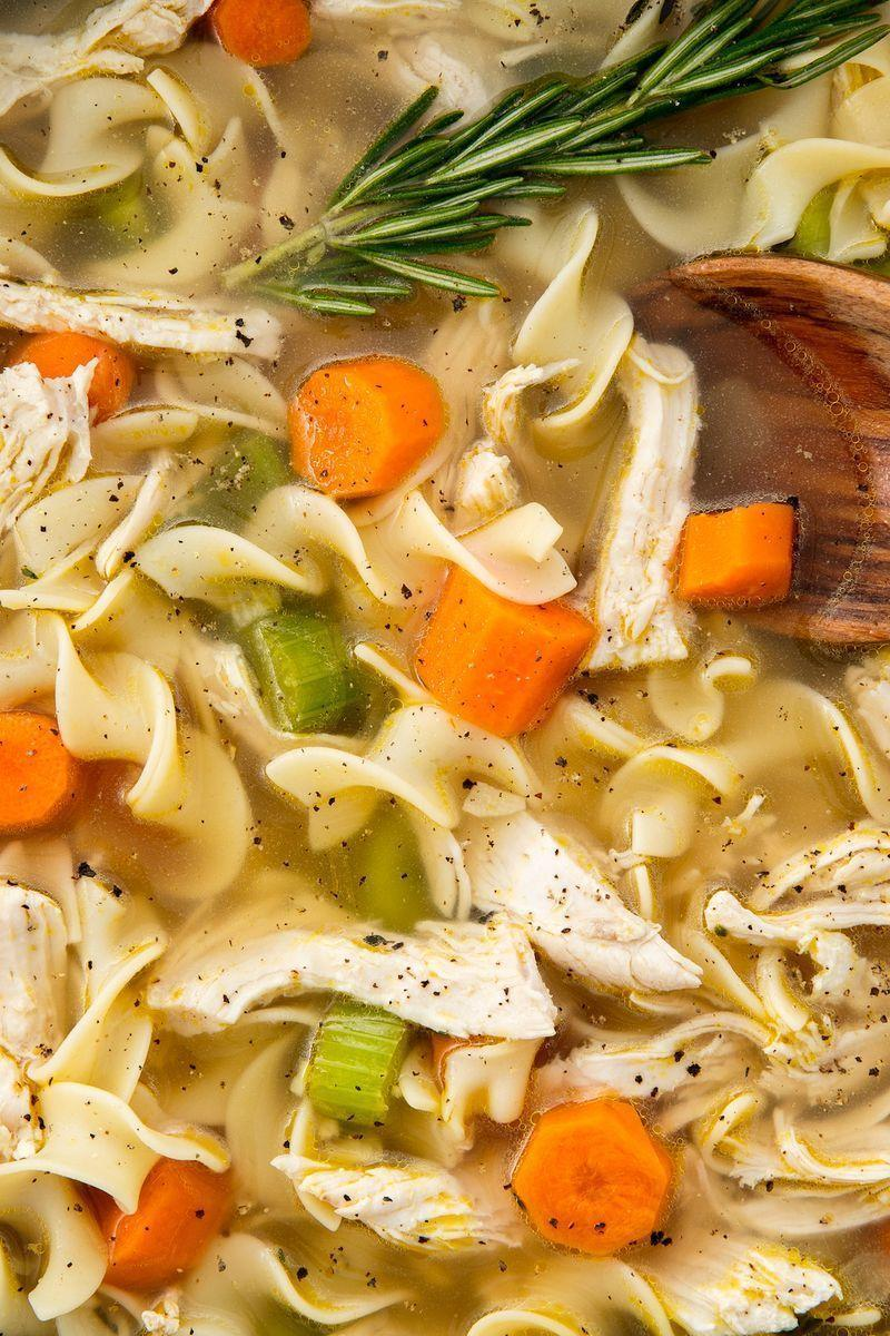 "<p>Homemade chicken noodle soup is already easy to whip up, but tossing all of your ingredients in a slow cooker makes it even easier. </p><p>Get the <a href=""https://www.delish.com/uk/cooking/recipes/a29124077/easy-crockpot-chicken-noodle-soup-recipe/"" rel=""nofollow noopener"" target=""_blank"" data-ylk=""slk:Slow Cooker Chicken Noodle Soup"" class=""link rapid-noclick-resp"">Slow Cooker Chicken Noodle Soup</a> recipe.</p>"