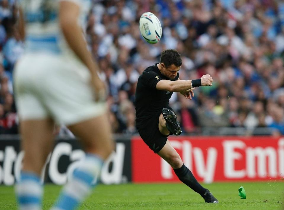New Zealand's fly-half Dan Carter kicks a conversion during their Rugby World Cup Pool C match against Argentina, at Wembley stadium in north London, on September 20, 2015 (AFP Photo/Adrian Dennis)