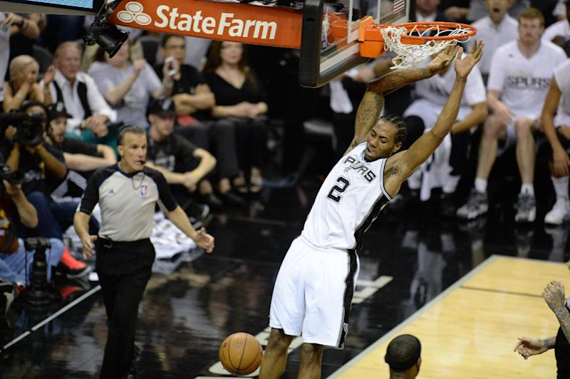 Kawhi Leonard of the San Antonio Spurs dunks the ball during the game against the Miami Heat in San Antonio on June 15, 2014