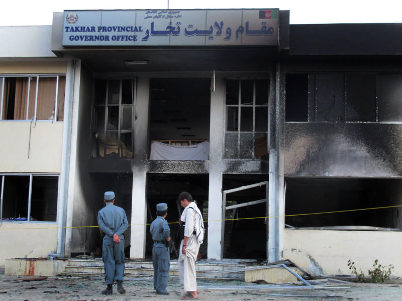 Afghan security stand at the site where a suicide bomber blew himself up inside the provincial governor's compound in Taloqan, Takhar province, north of Kabul, Afghanistan, Saturday, May 28, 2011. The German military says its top commander in Afghanistan was wounded Saturday when a suicide bomber attacked a provincial governor's compound in the north of the country. (AP Photo/ Fulad Hamdard)