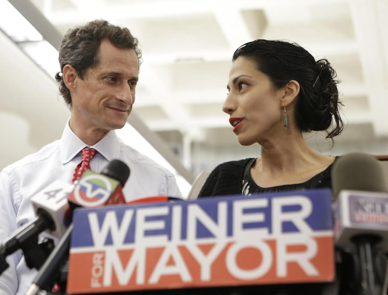 FILE - In this July 23, 2013 photo, Huma Abedin, alongside her husband, New York mayoral candidate Anthony Weiner, speaks during a news conference at the Gay Men's Health Crisis headquarters in New York. When Abedin's name and face first started appearing in the media six years ago, lots of people couldn't help but wonder what this beautiful, ambitious woman with high-fashion sense and a world-class rolodex saw in Anthony Weiner. That's a question New Yorkers are asking themselves again. (AP Photo/Kathy Willens, File)