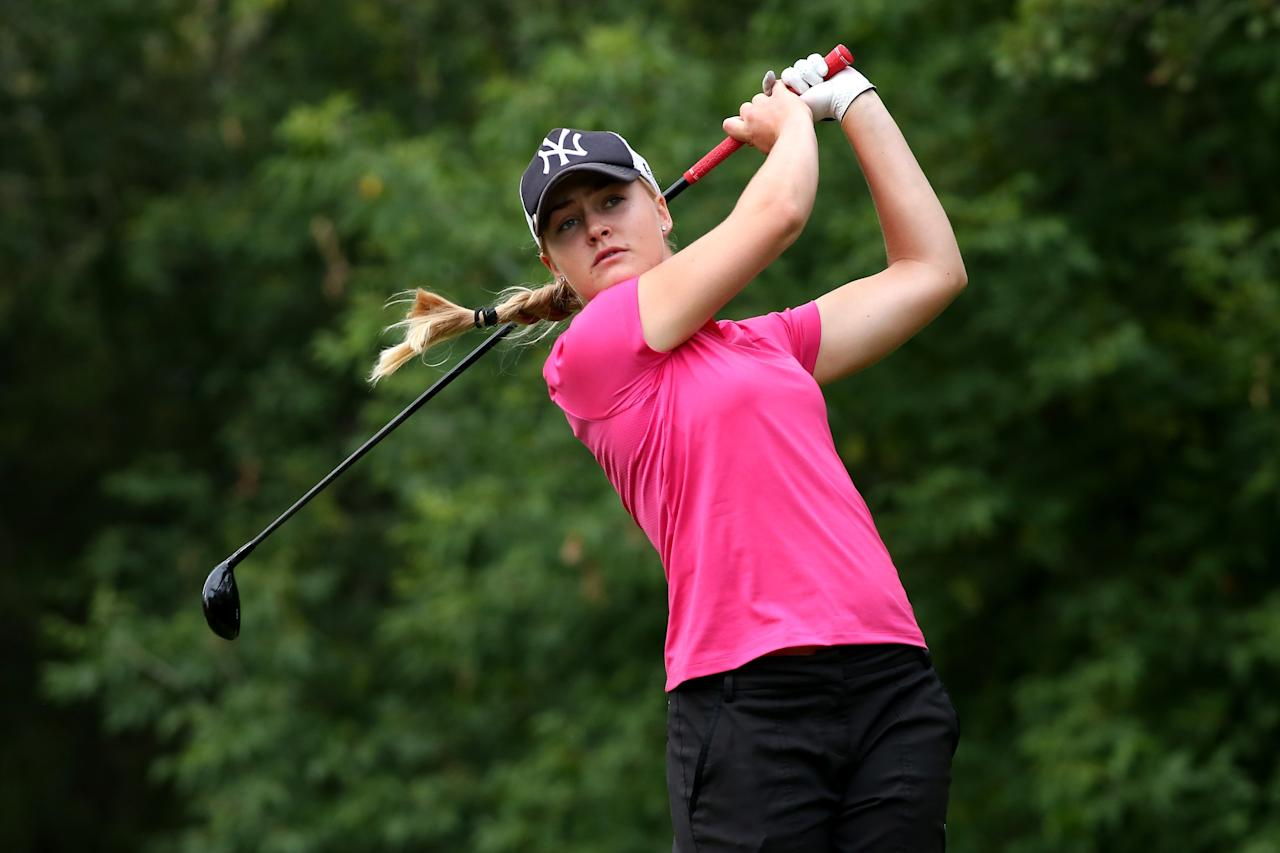 EDMONTON, AB - AUGUST 25: Charley Hull of England hits her tee shot on the fifth hole during the final round of the CN Canadian Women's Open at Royal Mayfair Golf Club on August 25, 2013 in Edmonton, Alberta, Canada. (Photo by Stephen Dunn/Getty Images)