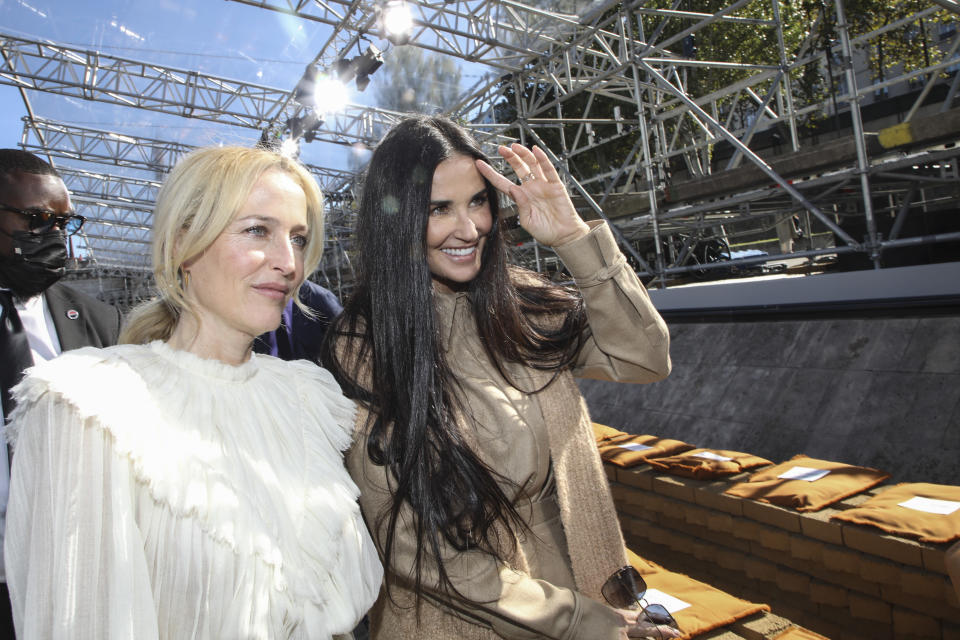 Gillian Anderson, left, and Demi Moore arrive for the Chloe Spring-Summer 2022 ready-to-wear fashion show presented in Paris, Thursday, Sept. 30, 2021. (Photo by Vianney Le Caer/Invision/AP)