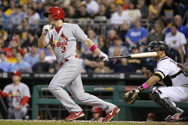 St. Louis Cardinals' Mark Ellis (3) drives in a run with a single off Pittsburgh Pirates starting pitcher Charlie Morton during the first inning of a baseball game in Pittsburgh Sunday, May 11, 2014. (AP Photo/Gene Puskar)