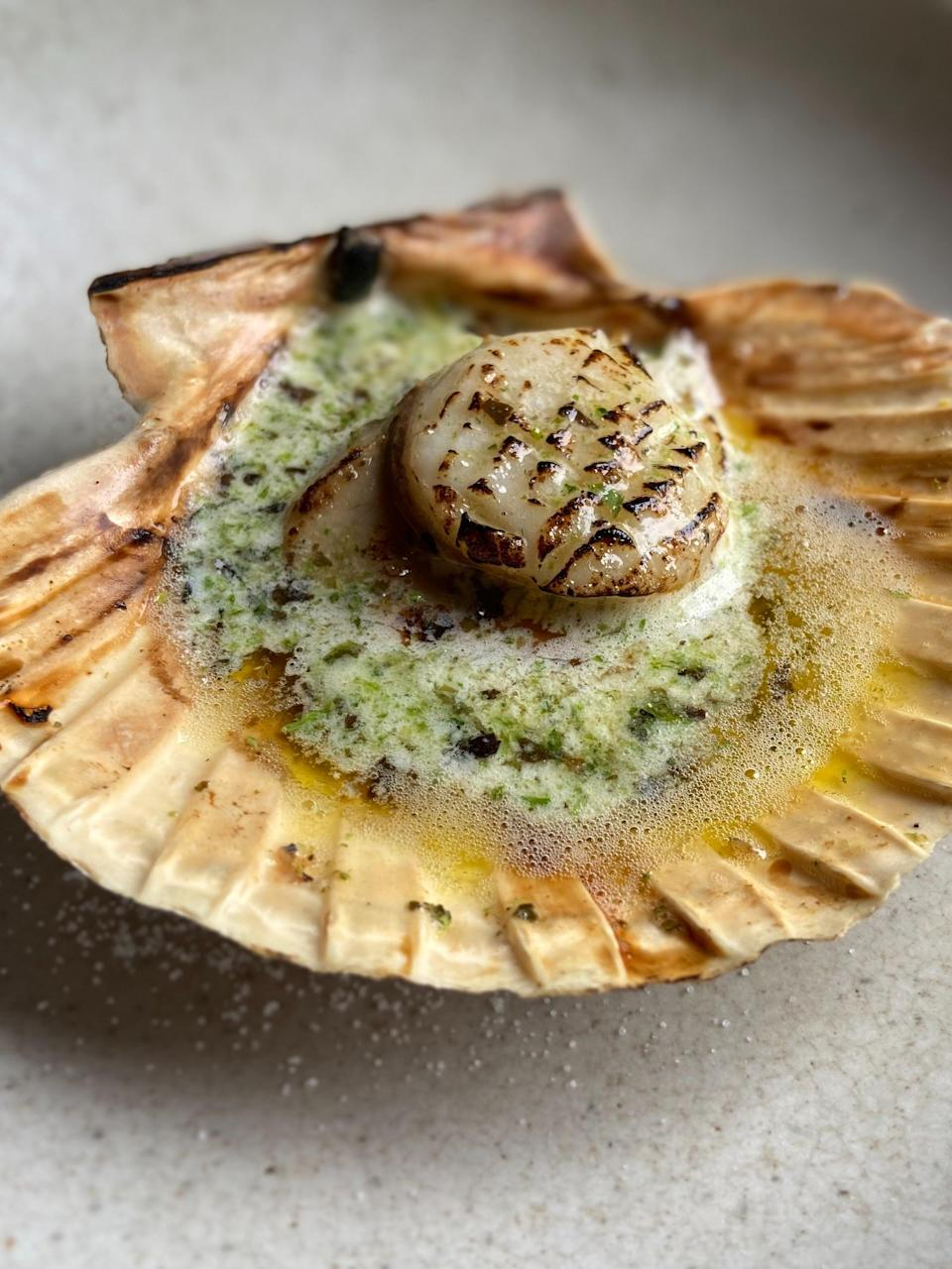 Char-kissed scallops, sea-sweet and cooked just beyond translucency, sitting in devotional pools of butter in their shells (The Rocket Store)