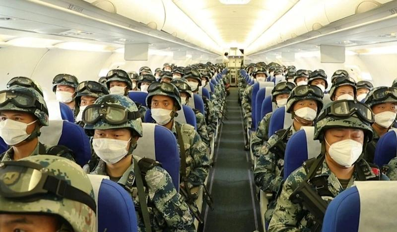 Chinese state television pictured military personnel onboard a plane amid the tensions. Source: Weibo