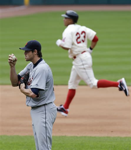 Detroit Tigers starting pitcher Doug Fister, left, waits for Cleveland Indians' Michael Brantley to run the bases on a solo home run in the sixth inning of a baseball game, Sunday, July 7, 2013, in Cleveland. (AP Photo/Tony Dejak)