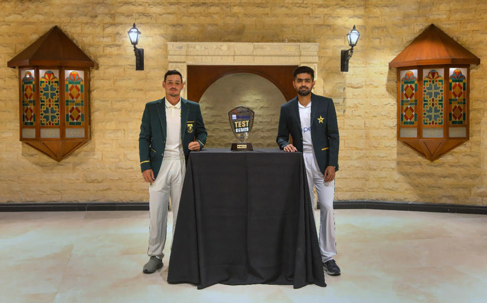 In this photo provided by Pakistan Cricket Board, Pakistan cricket team's skipper, Babar Azam, right, and his South Africa's counterpart Quinton de Kock pose for a photograph with the trophy of the test-series, in Karachi, Pakistan, Monday, Jan. 25, 2021. Pakistan and South Africa will play the first test match on Jan. 26. (AP Photo/Pakistan Cricket Board via AP)