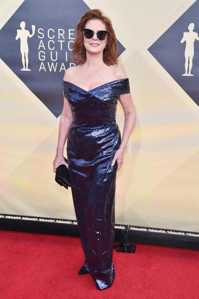 <p>Sarandon played it cool in a pair of sunnies to go with her custom blue sequin dress. (Photo: Getty Images) </p>