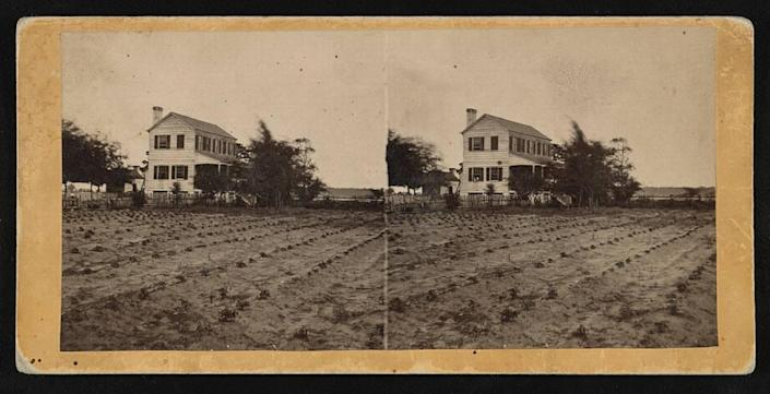 A plantation home sits on farmland near Beaufort, SC between 1862 and 1864.