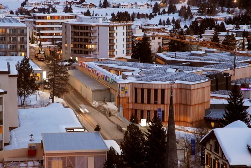A car drives past the congress centre, the venue of the World Economic Forum in Davos
