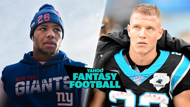 Is Christian McCaffrey a lock at the first overall pick in fantasy drafts or should managers consider Saquon Barkley instead? (Photos L-R by Scott Taetsch/Jacob Kupferman/Getty Images)