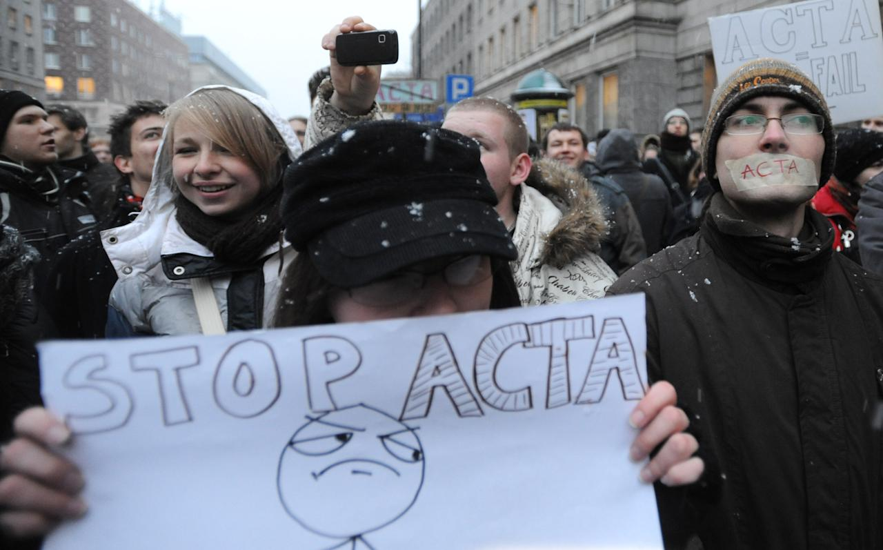 Internet activists protest against the international copyright agreement ACTA, the Anti-Counterfeiting Trade Agreement, in front of the European Parliament office in Warsaw, Poland, Tuesday, Jan. 24, 2012. The Polish government plans to sign the agreement and Poland's support for ACTA has sparked days of protest, including attacks on government sites, by groups who fear it could lead to online censorship. (AP Photo/Alik Keplicz)