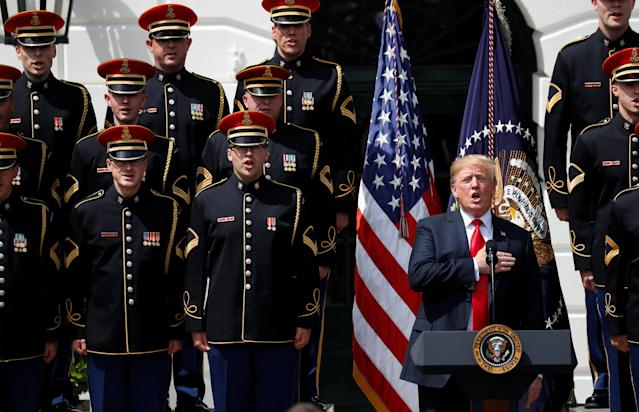 "U.S. President Donald Trump holds his hand over his heart and sings the U.S. National Anthem along with members of the U.S. military at the ""celebration of America"" event on the South Lawn of the White House in Washington, U.S., June 5, 2018. The event was arranged after Trump canceled the planned visit of the Super Bowl champion Philadelphia Eagles to the White House. REUTERS/Kevin Lamarque"