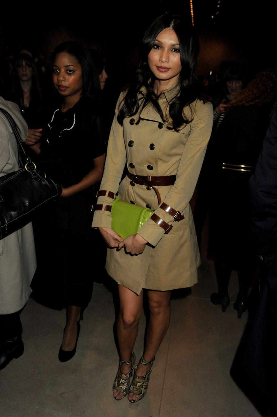 <p>The Burberry FROW could not be complete without classic nods to the brand's unforgettable heritage. </p><p>Chan wore a refreshed Burberry Kensington cotton-gabardine trench with a lime green clutch and neon snake skin caged heels for the show.</p>