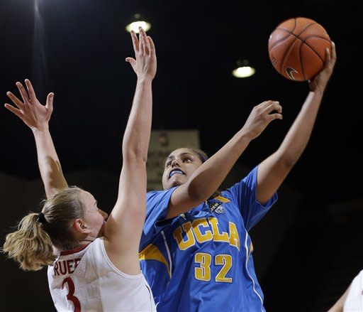 UCLA 's Alyssia Brewer (32) shoots over Stanford 's Mikaela Ruef (3) during the second half of an NCAA college basketball game in Stanford, Calif., Friday, Jan. 18, 2013. (AP Photo/Marcio Jose Sanchez)