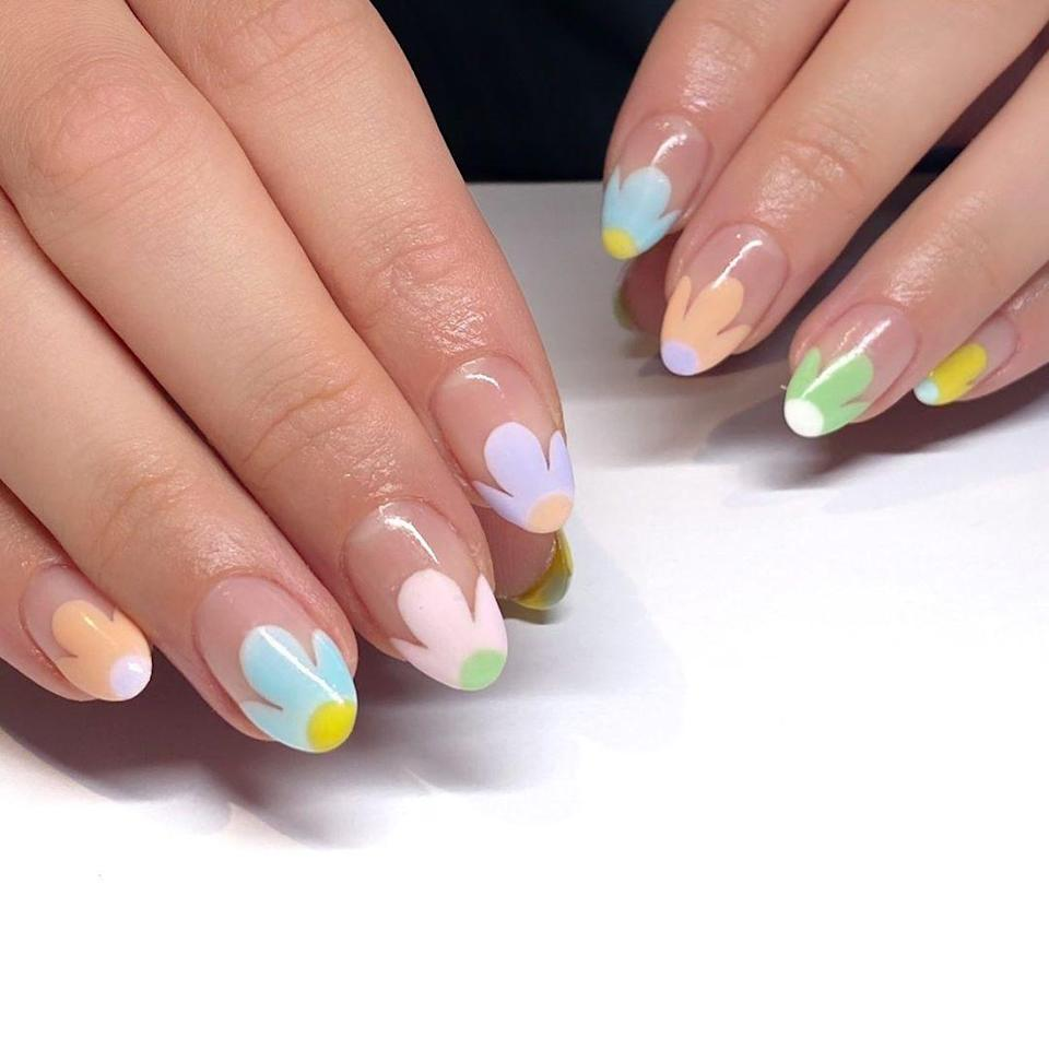 Starting to get tired of the French mani? Switch it up with tips that actually resemble flowers. It has the same nail-lengthening effect as the original, just way more interesting.
