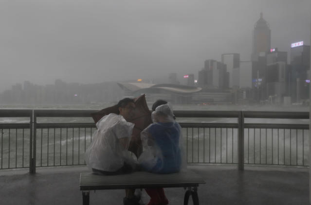 <p>People play with strong wind caused by Typhoon Hato on the waterfront of Victoria Habour in Hong Kong, Wednesday, Aug. 23, 2017. (Photo: Vincent Yu/AP) </p>