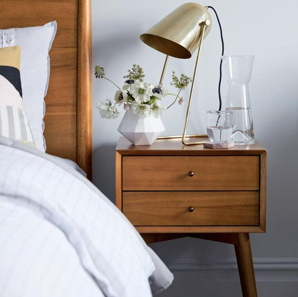 <p>Classic and polished, this <span>West Elm Mid-Century Nightstand</span> ($349 - $399) was built to last.</p>