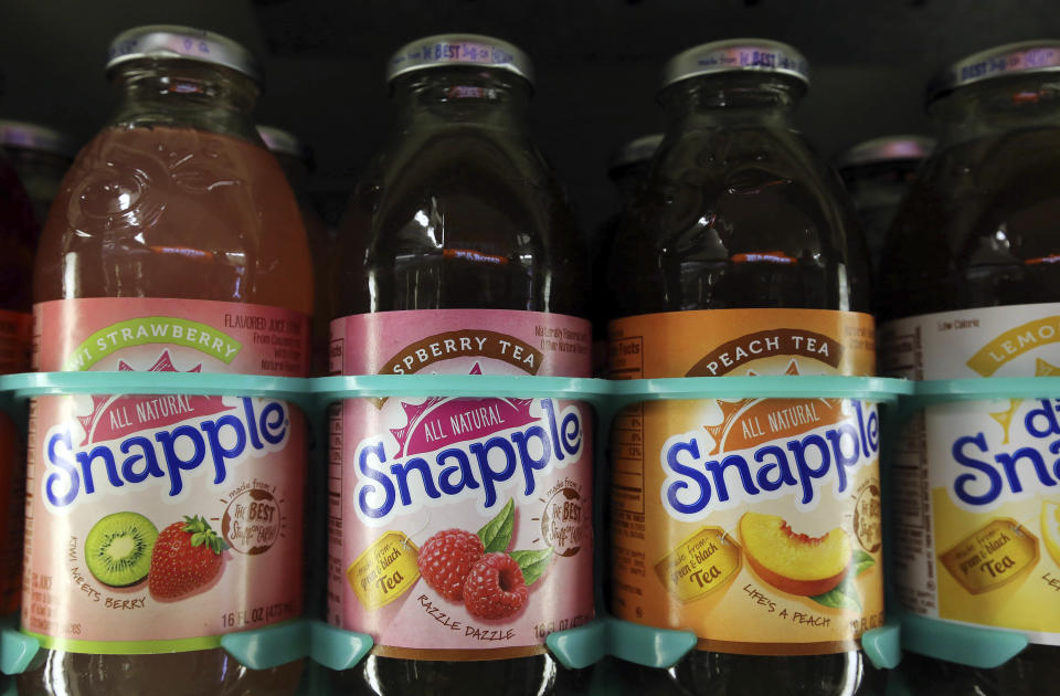"""FILE - This April 28, 2016, file photo shows bottles of Snapple in a cooler at Quality Cash Market in Concord, N.H. On Friday, May 14, The Associated Press reported on stories circulating online incorrectly claiming the underside of a Snapple lid shows the company included, """"Trump lost and the election was not stolen,"""" as a """"Real Fact"""" the company prints on its beverage lids. (AP Photo/Jim Cole, File)"""