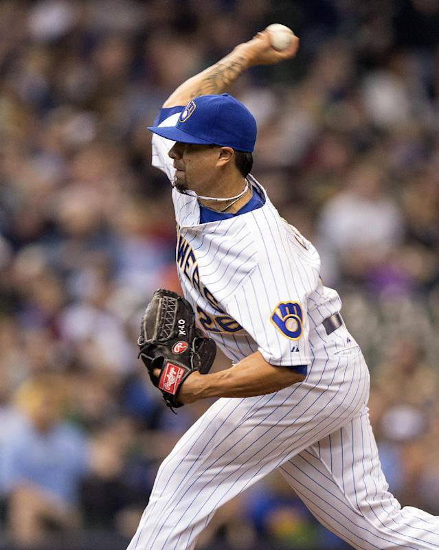 Milwaukee Brewers' Kyle Lohse pitches to Pittsburgh Pirates' Starling Marte during the first inning of a baseball game on Sunday, April 13, 2014, in Milwaukee. (AP Photo/Tom Lynn)