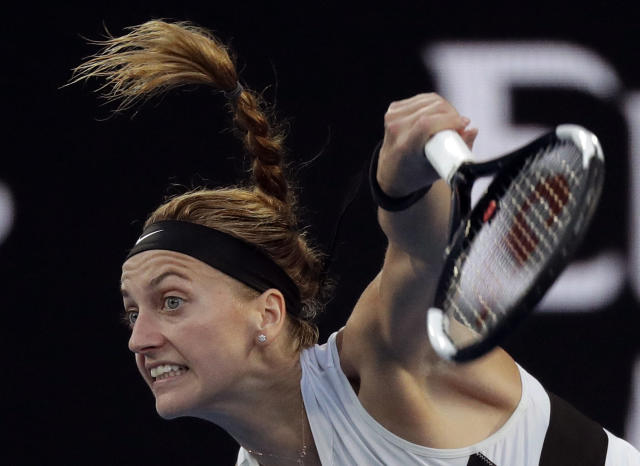 Petra Kvitova of the Czech Republic serves to Australia's Ashleigh Barty during their quarterfinal match at the Australian Open tennis championships in Melbourne, Australia, Tuesday, Jan. 22, 2019. (AP Photo/Kin Cheung)