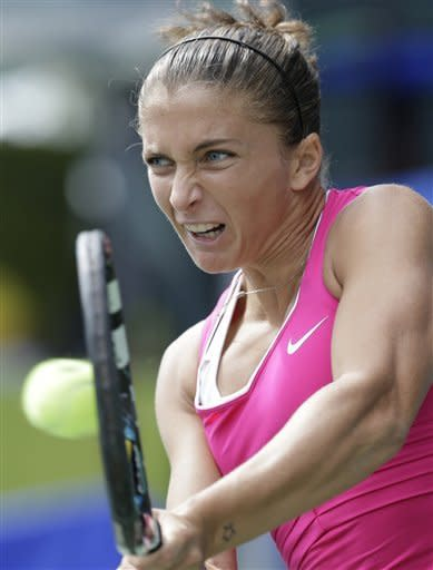 Sara Errani of Italy returns a ball against Nadia Petrova of Russia during her quarter-final match of the Pan Pacific Open Tennis in Tokyo Thursday, Sept. 27, 2012. (AP Photo/Koji Sasahara)