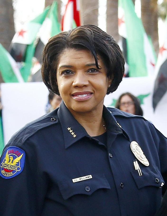In this Jan. 16, 2017 photo, Phoenix Police Chief Jeri Williams poses for a photograph with other city leaders prior to leading a Martin Luther King Jr. Day march in Phoenix. Williams is among the growing number of women heading departments, many in need of image makeovers. (AP Photo/Ross D. Franklin)