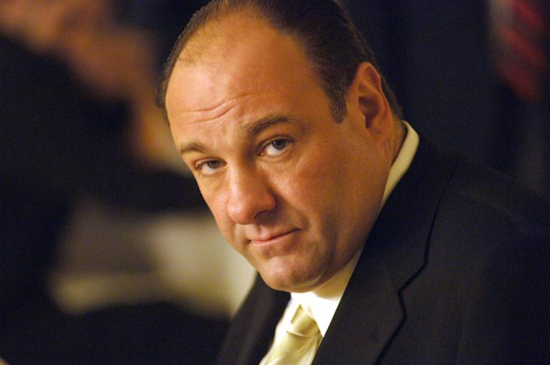"""FILE - This undated publicity photo released by HBO, shows actor James Gandolfini in his role as Tony Soprano, head of the New Jersey crime family portrayed in HBO's """"The Sopranos."""" Funeral services for actor James Gandolfini are scheduled for Thursday, June 27, 2013, at the Cathedral Church of Saint John the Divine in New York City. Gandolfini died June 19, 2013 in Italy. He was 51. (AP Photo/HBO, Barry Wetcher, File)"""