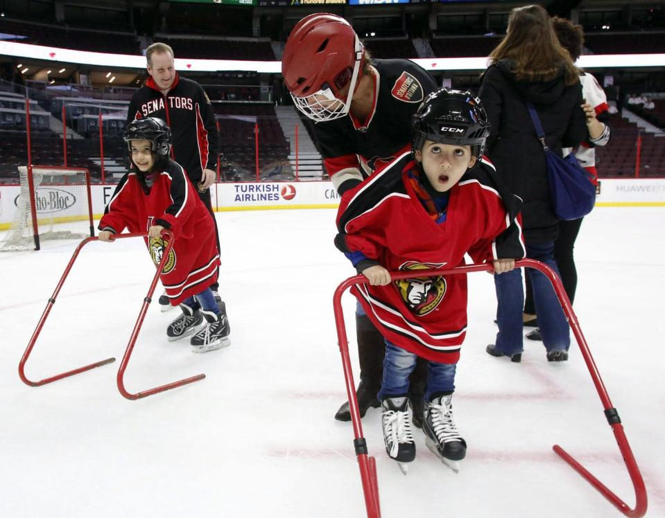 """<span class=""""caption"""">Newly arrived refugee children learn how to skate from Ottawa Senators staff in Ottawa in March 2016. </span> <span class=""""attribution""""><span class=""""source"""">THE CANADIAN PRESS/Fred Chartrand</span></span>"""